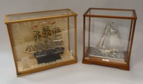 """A Japanese white metal model of a sail boat stamped """"silver 970"""" the five sided glazed case dated"""