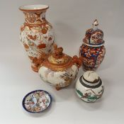A collection of Japanese pottery and porcelain to include a late Meiji period Kutani tsukuru vase -