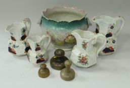 A set of three graduated hydra jugs together with another similar,