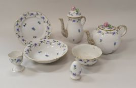 """A Herend """"Cornflower"""" pattern duet breakfast set comprising cups and saucers, cereal bowls,"""