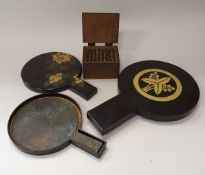 Three Japanese bronze hand mirrors in lacquered cases together with a 48 piece printing block set