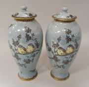 """A pair of Carlton ware """"Armand"""" lustre ware vases decorated with birds amongst blossoming branches"""