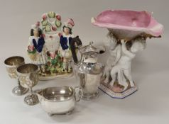 A collection of eight various Staffordshire pottery figures, three fairings,