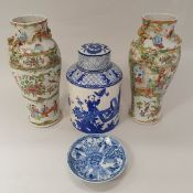 A pair of Chinese famille rose porcelain vases decorated with panels of figures and with dragon