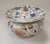 A Chinese Imari pot and cover with all over blue underglaze and oxide red and gilt overglaze floral