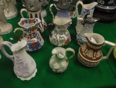 A collection of matt biscuit fired relief work jugs including a William Brownfield baluster shaped