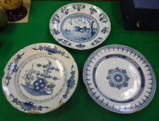 An 18th Century Dutch Delft ware charger decorated with a harbour entrance scene with sailing
