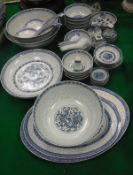 "A collection of various modern Chinese blue and white ""rice"" pattern dinner wares including various"