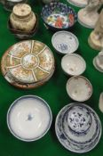 A collection of small Oriental porcelain and pottery to include Satsuma bowl and lidded vase,