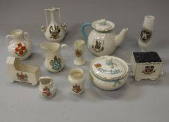 A collection of approximately 75 pieces of crested china wares, including Willow, Gemma, Foley,