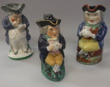 A 19th Century seated Toby jug with tricorn hat and jug of ale,