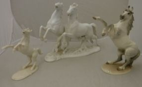 """An Austrian blanc-de-chine pottery figure group of """"Two horses"""" by Keramos of Vienna, No."""