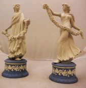 A pair of Wedgwood Jasperware figures from The Dancing Hours Collection by Ivy Garland, No'd.