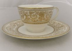 """A set of twelve Royal Doulton """"Sovereign"""" pattern gilt decorated coffee cups and saucers (H4973)"""