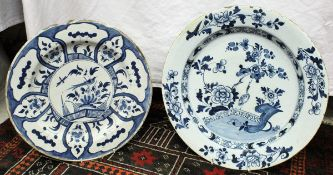 A 19th Century Delft charger decorated with crane and fence pattern,