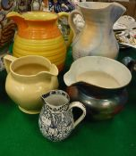 A Shelley red and orange glazed ribbed jug, a Beswick ware ribbed jug,
