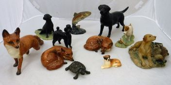"""A collection of various porcelain and pottery figures including Beswick """"Recumbent Fox"""" (1017) (x"""