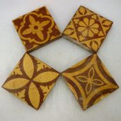 Four glazed terracotta tiles in the encaustic style by W.