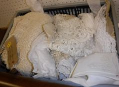 A box of assorted table linen together with various vintage lace collars, sections,