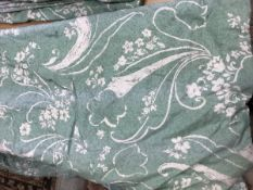 Two pairs of cotton green and cream foliate decorated interlined curtains with fixed triple pinch