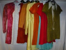 A collection of vintage 1960's clothing, mainly Sizes 8-10, comprising an orange suede dress,