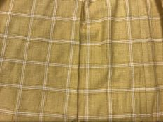 Three pairs of Colefax & Fowler linen type yellow checked interlined curtains with fixed triple