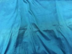 A pair of turquoise shot silk with contrasting band and piping on one edge interlined curtains with