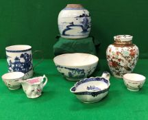 An 18th Century Chinese blue and white ginger jar (no cover), a polychrome decorated jar and cover,