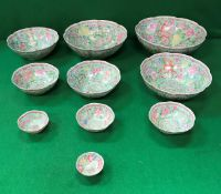 A graduated set of ten late 20th Century Chinese Gingdezhen polychrome decorated bowls bearing faux