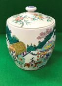 A Chinese famille-rose barrel shaped jar and cover,