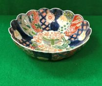 A Chinese Imari bowl of lobed form with polychrome decorated panels,