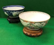 A Chinese famille-rose and blue and white decorated fruit bowl with panels of figures in garden