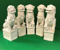 Five 19th Century Chinese blanc-de-chine figures of temple lions,