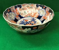 A 19th Century Chinese Imari bowl of ribbed form,
