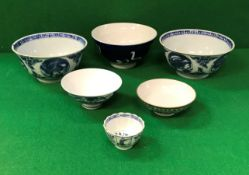Two Chinese blue and white bowls decorated with dragons,
