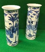A pair of 19th Century Chinese blue and white cylindrical vases with flared rims,
