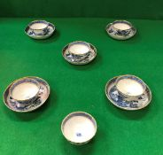A set of six 19th Century Chinese blue and white tea bowls with gilt decoration,