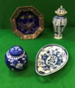 A blue and white leaf shaped dish decorated with panels of figures and flowers,