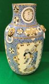 A 20th Century Vietnamese blue and brown glazed vase with incised decoration of panels of figures