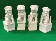 A collection of four Chinese blanc-de-chine figures of temple lions,