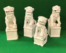 A collection of four 19th Century Chinese blanc-de-chine figues of temple lions,