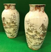 A pair of circa 1900 Japanese Meiji Period vases of ribbed baluster form,