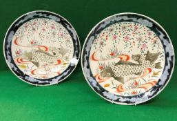 Two Japanese polychrome decorated plates, the centre field painted with carp and blossom,
