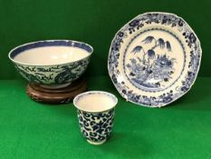 A Chinese Kangxi blue and white bowl decorated with four toed dragons,