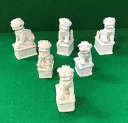 A collection of six 19th Century Chinese blanc-de-chine figures of temple lions,