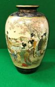 An early 20th Century Japanese Satsuma ware vase decorated with panels of figures in a garden