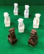 A collection of five 19th Century Chinese blanc-de-chine figures of temple lions, approx 12 cm high,