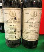 Two bottles La Cour Pavillon Médoc 1975 and two bottles Fonset-Lacour Bordeaux Barton & Guestier