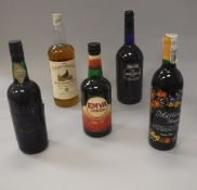 A mixed lot of wines and spirits including Harveys Bristol Cream Sherry 1 litre and 75cl,
