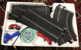 Two boxes containing Scalextric track an